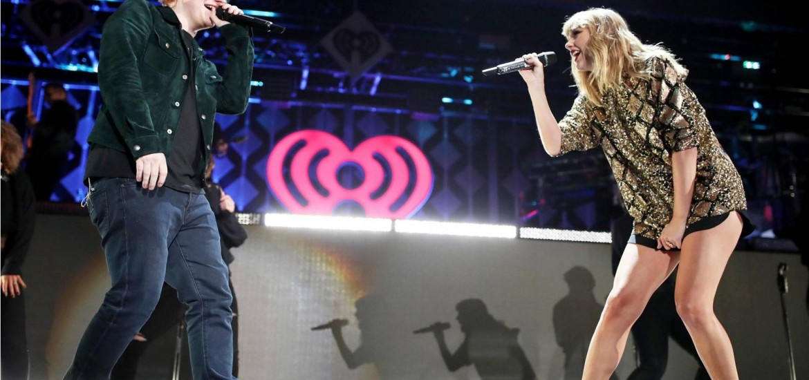 INGLEWOOD, CA - DECEMBER 01:  (EDITORIAL USE ONLY. NO COMMERCIAL USE)  Ed Sheeran (L) and Taylor Swift  perform onstage during 102.7 KIIS FM's Jingle Ball 2017 presented by Capital One at The Forum on December 1, 2017 in Inglewood, California.  (Photo by Christopher Polk/Getty Images for iHeartMedia)
